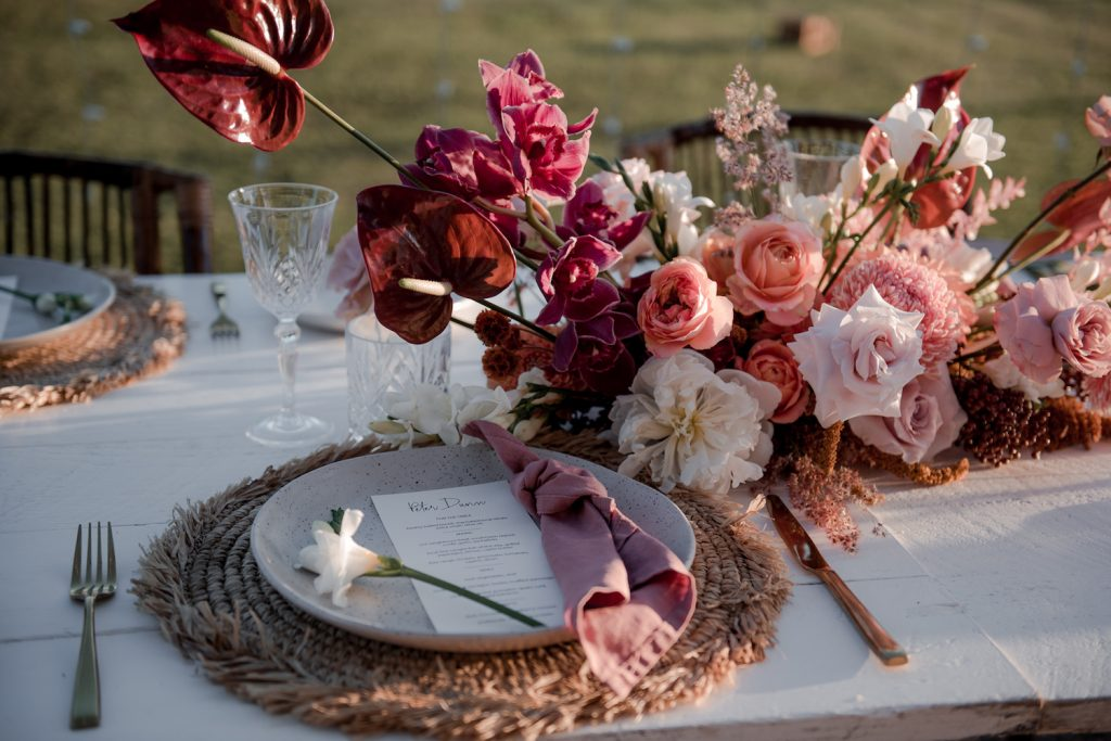 Wedding reception table set up with flowers in Byron Bay / Elope