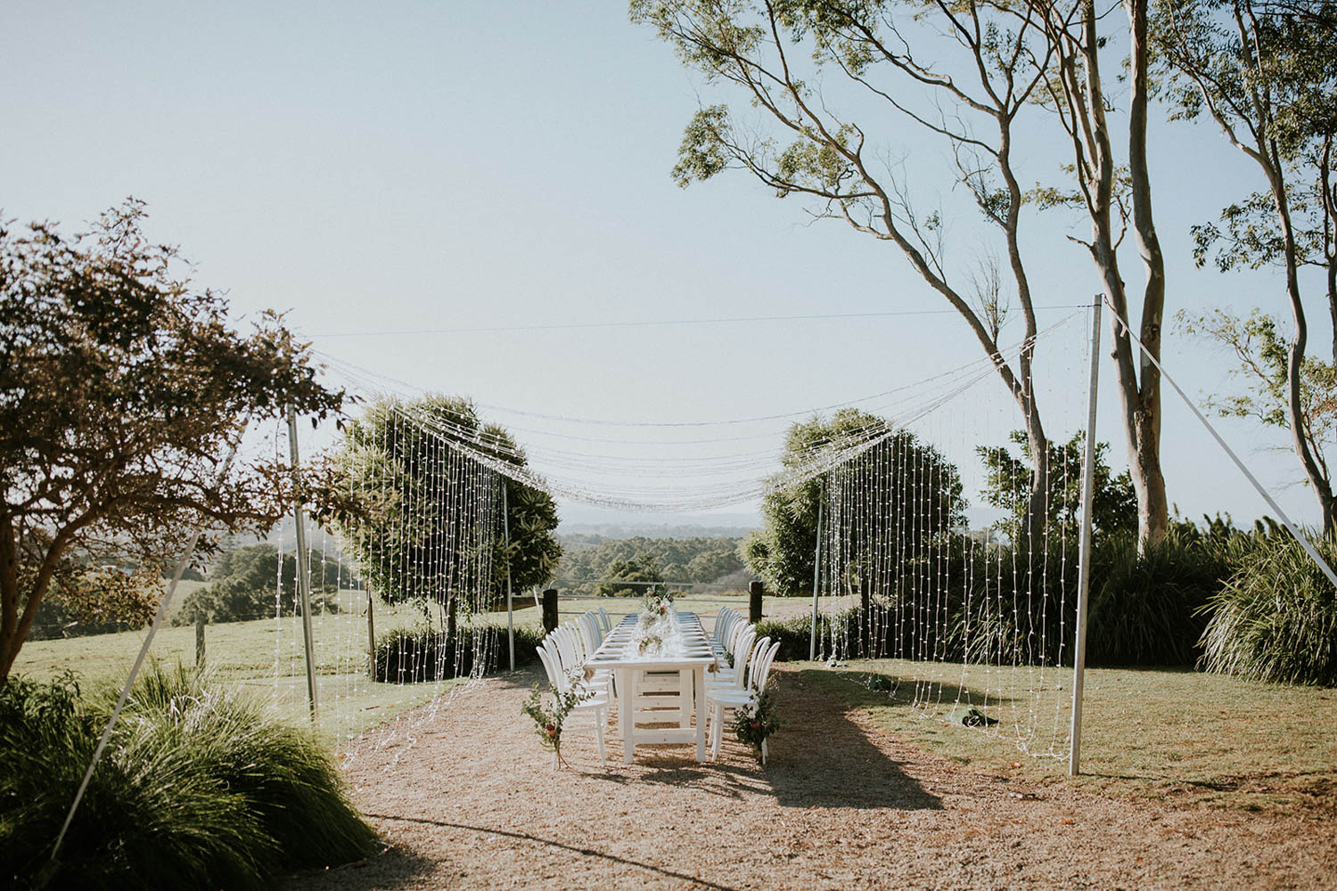 Reception table decorations with fairy lights / Byron Bay wedding