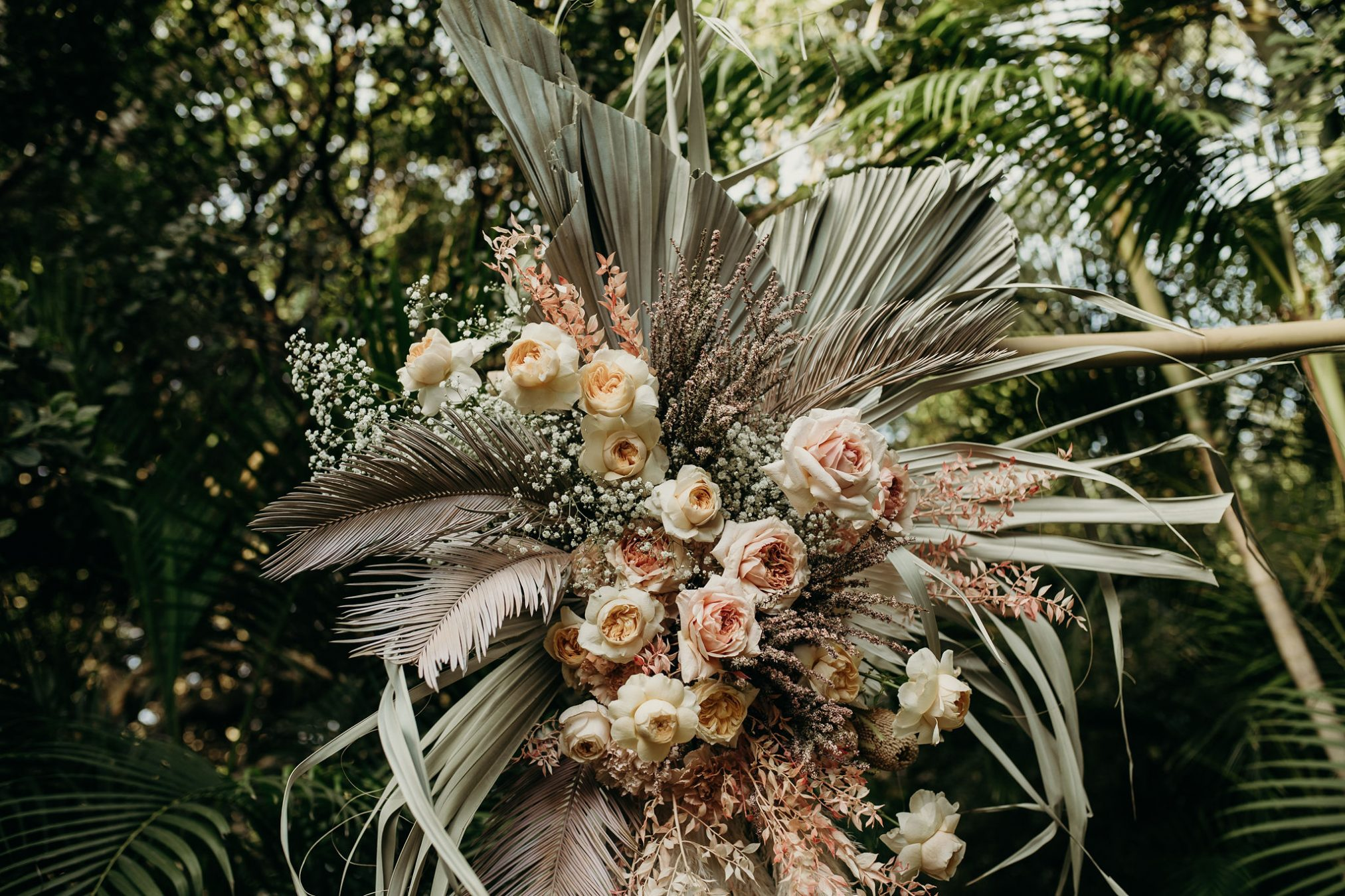 Close up of flowers with palms in background / Broken Head wedding
