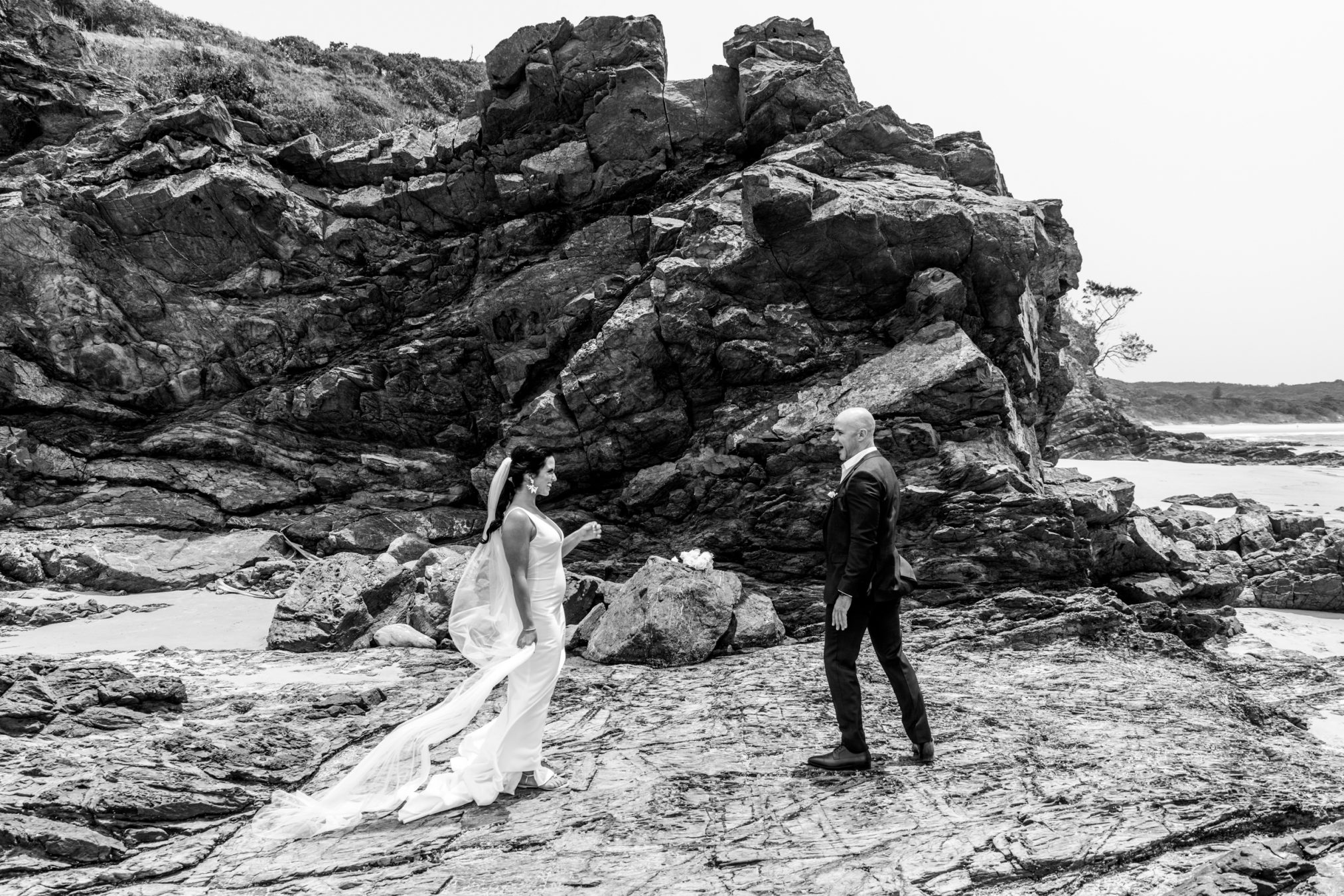 Bride and groom amongst rocks in Broken Head Byron