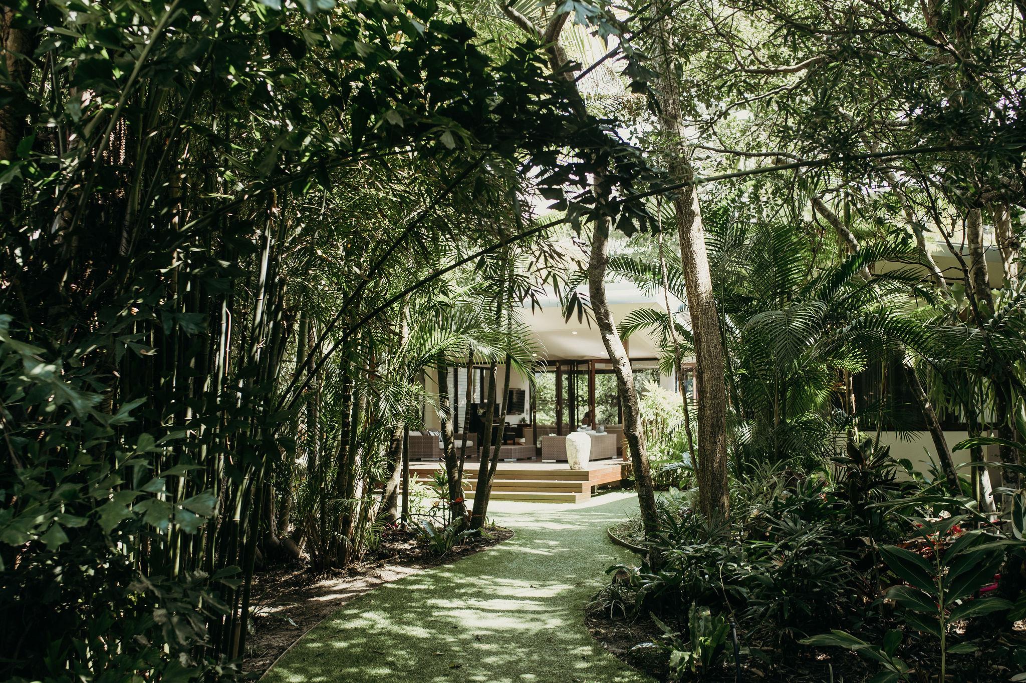 House in greenery / Broken Head Wedding