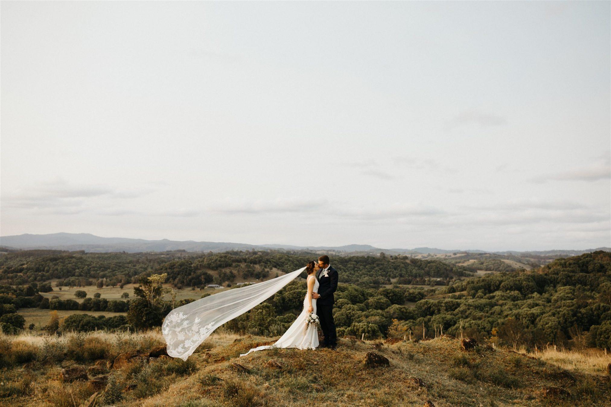 Bride and groom kissing / Byron Bay hinterland