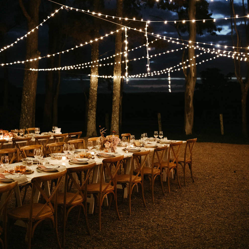 Reception table set up with flowers and fairy lights in Byron Bay