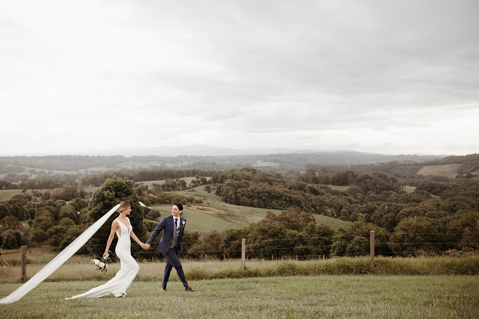 Bride and groom in Temple Farmhouse garden - Byron Bay.
