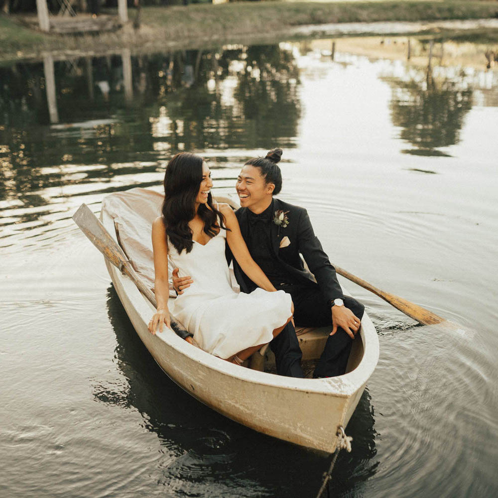 Bride and groom in boat / wedding photography