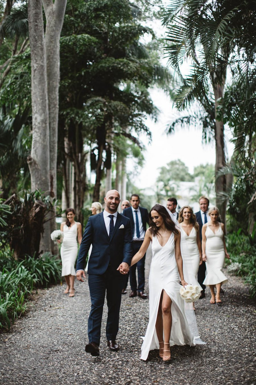 Bridle party walk down path / wedding photography