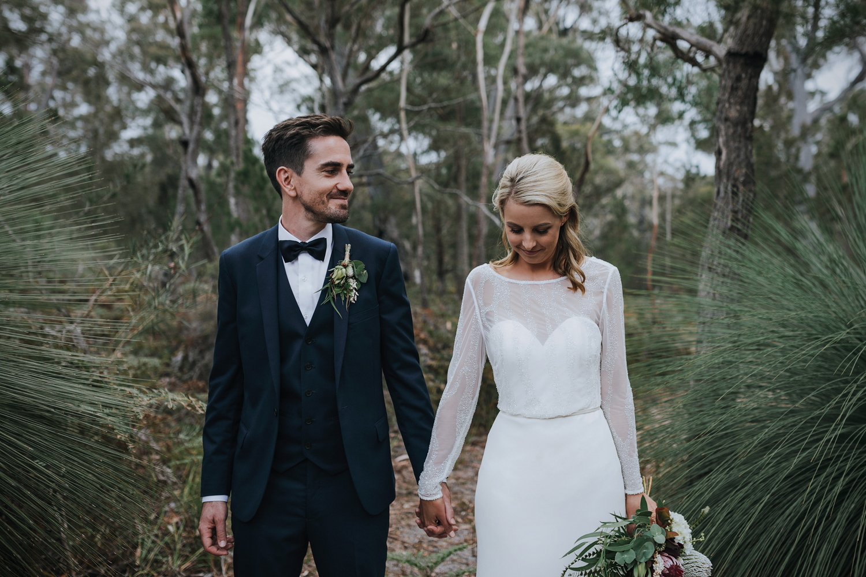 Groom smiles at his bride at Bay of Fires bush retreat wedding.