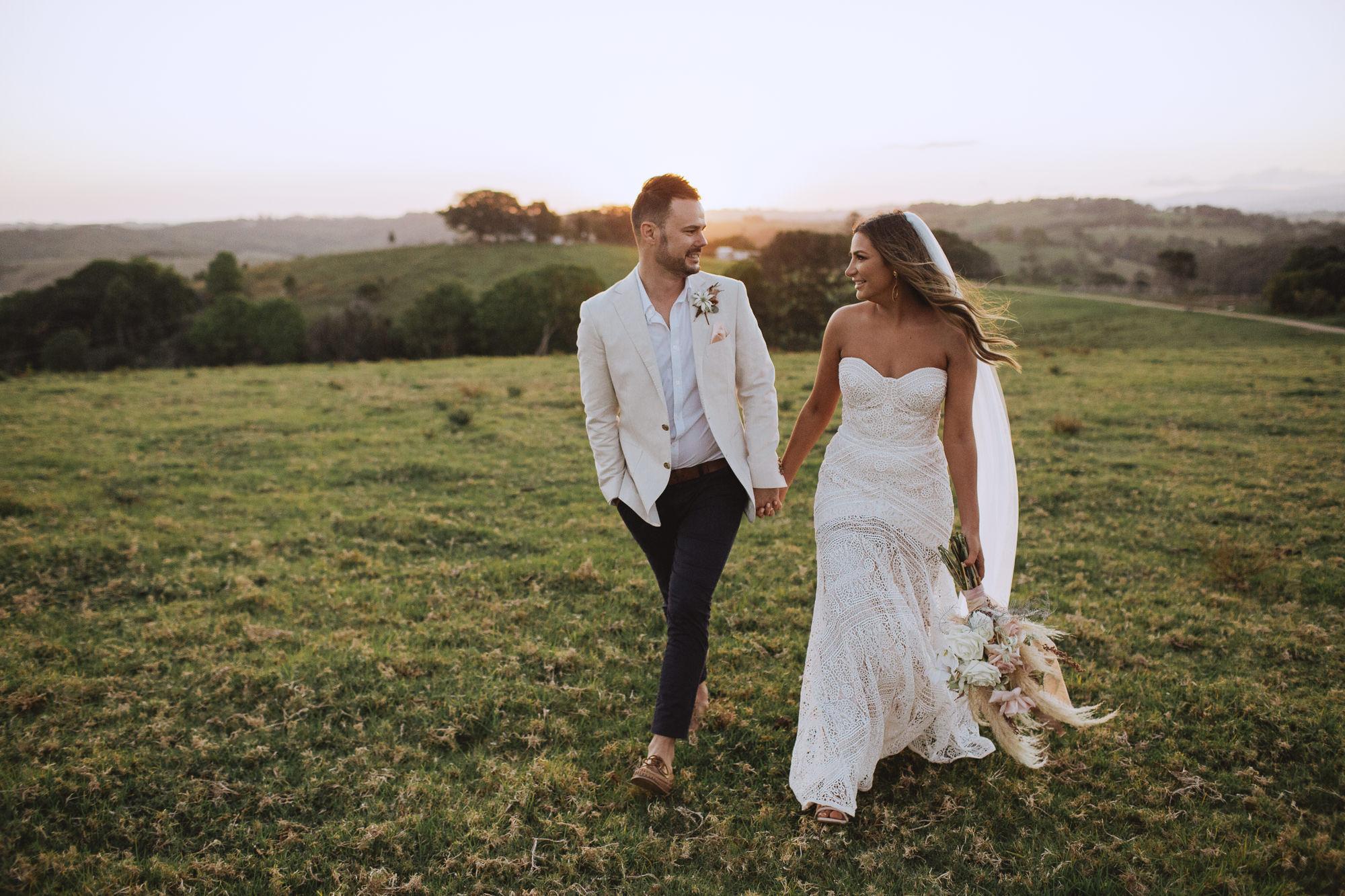 Bride and groom walking through Byron hinterland