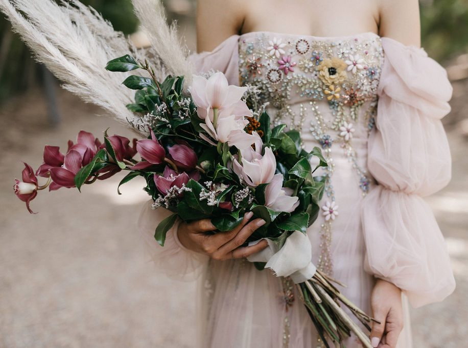 Close up of wedding dress and bouquet