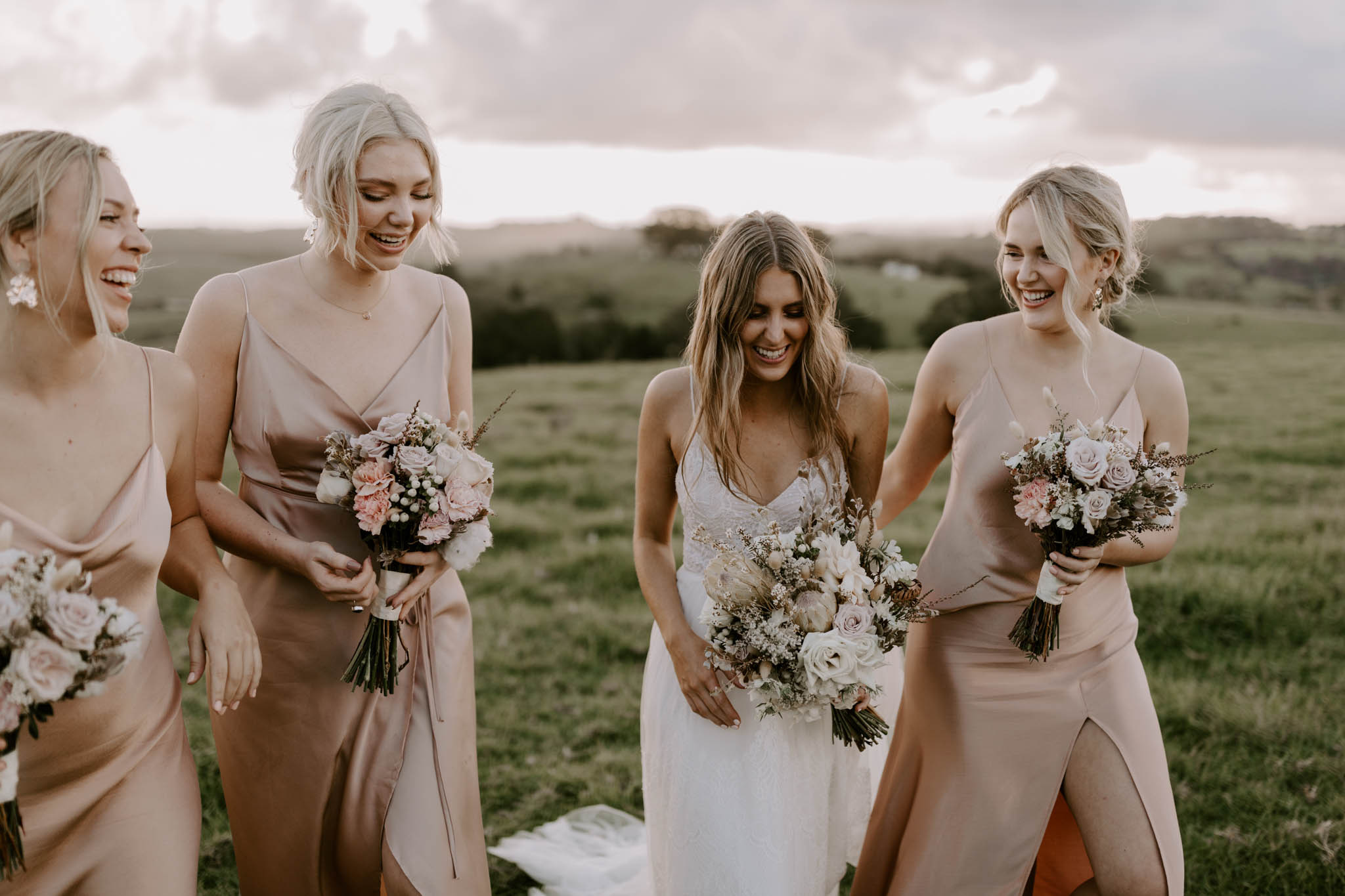 Bridle party smiling in hinterland / Wedding photography