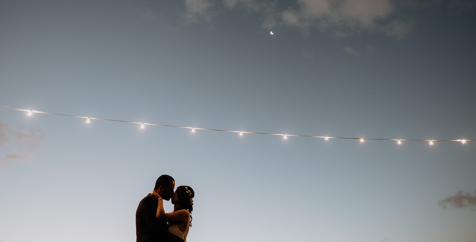 Bride and groom kissing at sunset / Elopement photography