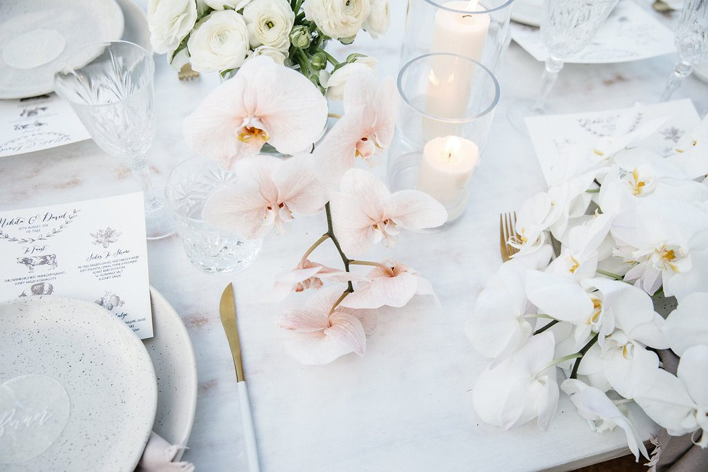 Reception table set up with soft flowers / Wedding photography