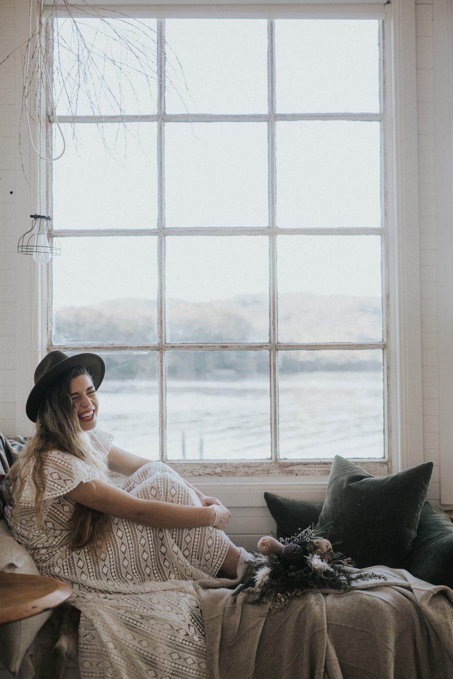 Bride laughing in rustic house - Captains Rest Tasmania / Elopement photography