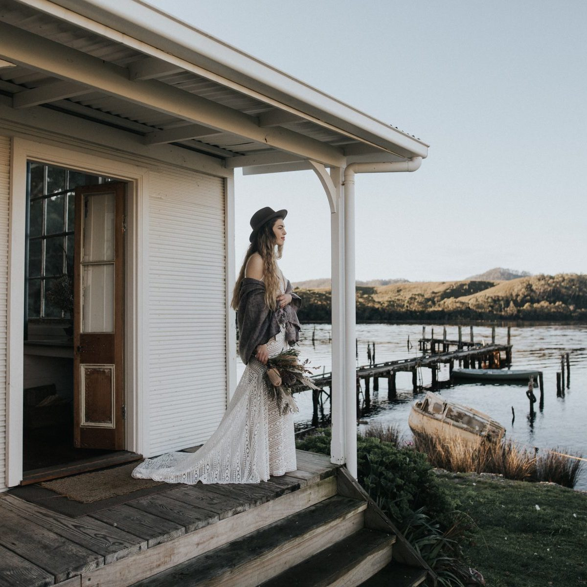Bride in Tasmanian wooden house with view to river