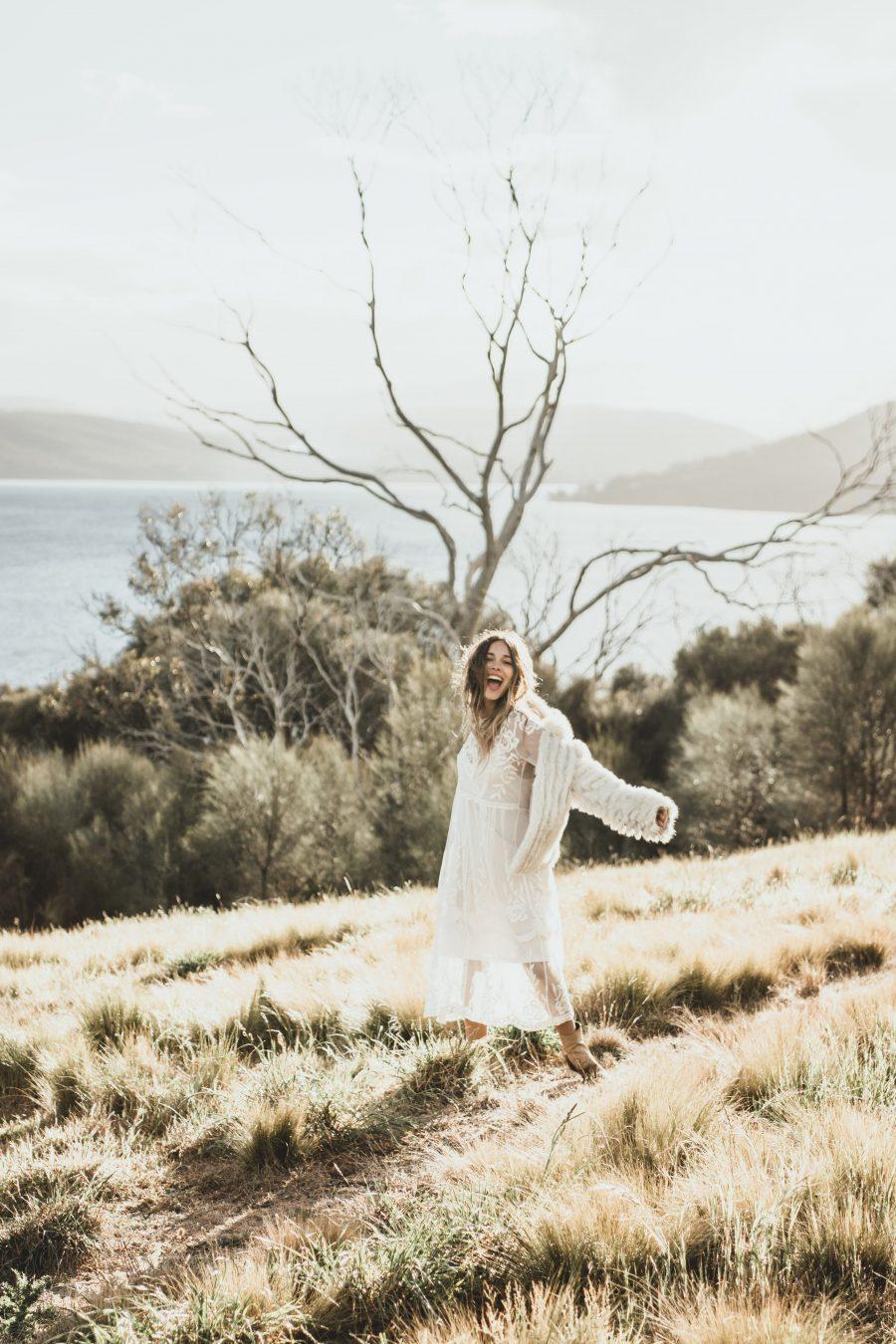 Bride smiling in Tasmania Hilltop