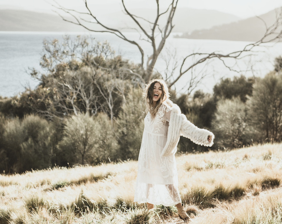 Bride smiling on Tasmania Hilltop