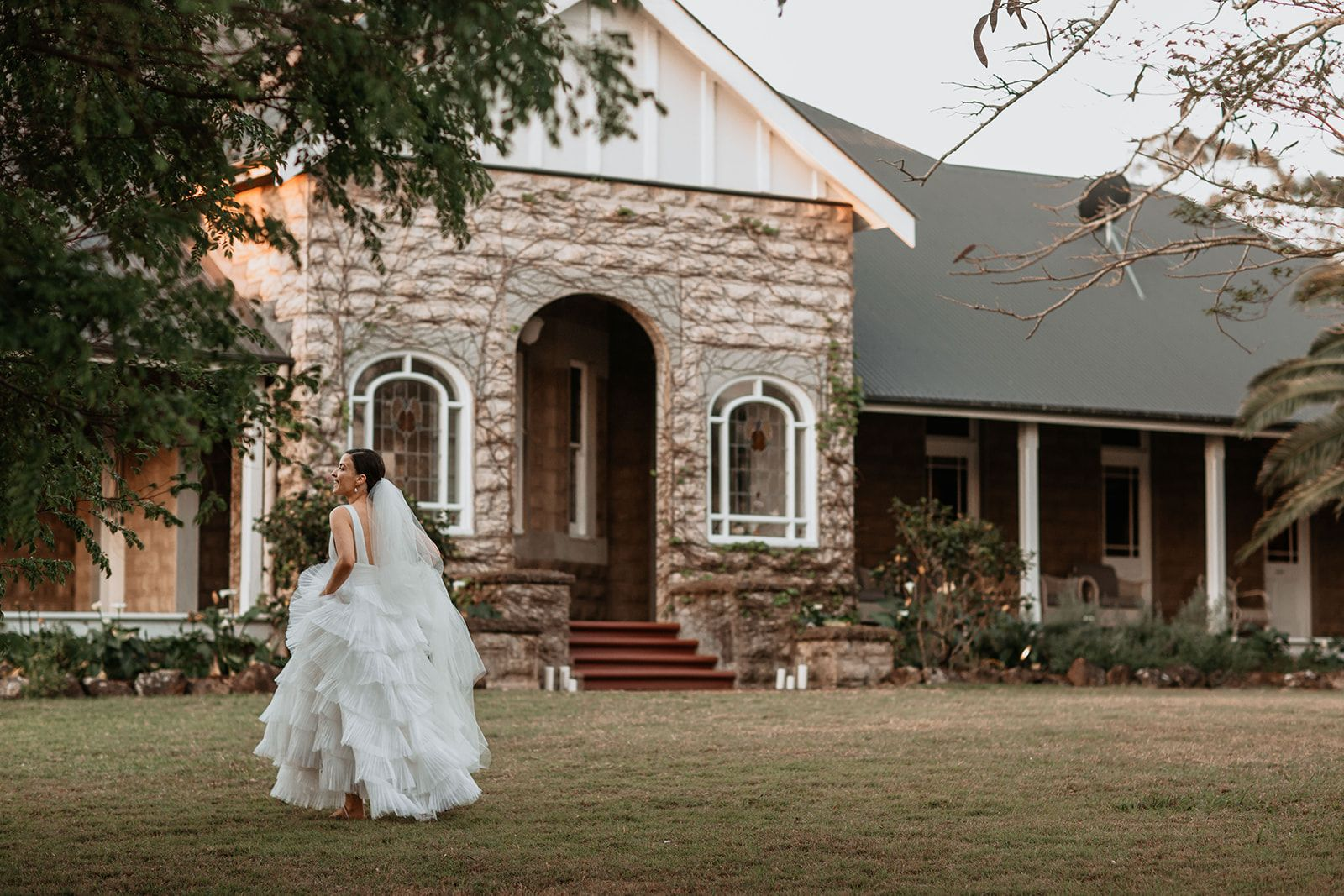 Bride walking towards Byron Bay hinterland house.