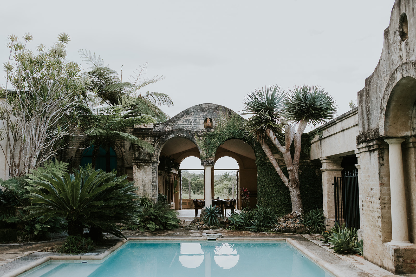 Image of rustic villa / building pool area.